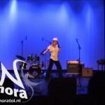 Nora performing