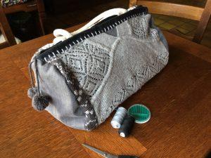 Grey hand bag