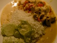 Chicken goulash with rice and cucumber salad